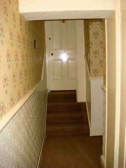 The narrow hall at the top of the stairs