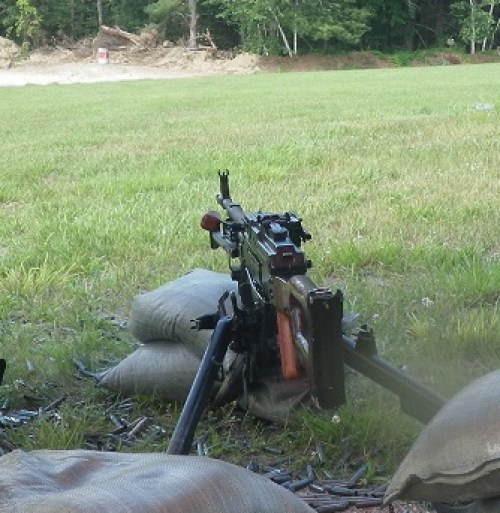 Russian PKM Machine Gun, Tripod-Mounted, Belt-Fed, firing the 7.62 x 54 round.