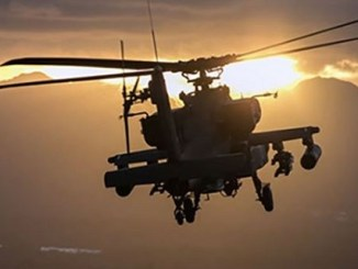 A U.S. Army AH-64 Apache helicopter flies at Schofield Barracks, Hawaii, Dec. 17, 2018. (U.S. Army photo by 1st Lt. Ryan DeBooy)