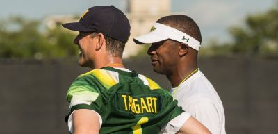 2016 USF Satellite Camps Jim Harbaugh Wearing Willie Taggart Jersey USF Michigan SNAP Large (1214x585)