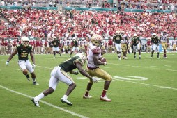 FSU vs USF 2016 102 - Jaymon Thomas tackles Jesus 'Bobo' Wilson with Nate Godwin by Dennis Akers (3127x2085)