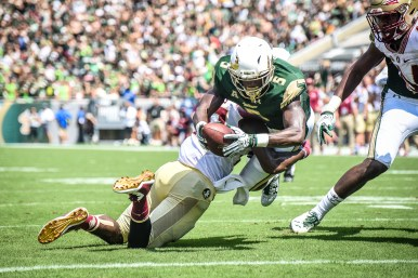 FSU vs USF 2016 66 - Marlon Mack and Nate Andrews hit on Marlon Mack at the goaline for the Bulls touchdown by Dennis Akers (3918x2612)