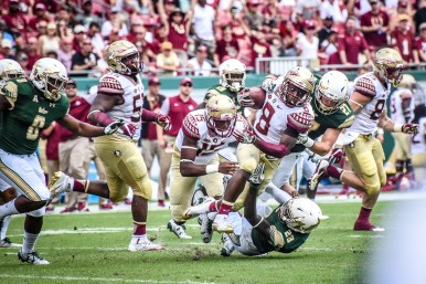 FSU vs USF 2016 97 - Kermit Whitfield tackled by Mazzi Wilkins and Austin Hudson by Dennis Akers (3296x2197)