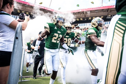 26 USF vs ECU 2016 - USF DB Mazzi Wilkins RB Trevon Sands and S Khalid McGee exiting the tunnel (6016x4016)