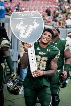 111 - USF vs. UCF 2016 - USF S Nate Godwin exiting with #WarOnI4 Trophy by Dennis Akers | SoFloBulls.com (2923x4378)
