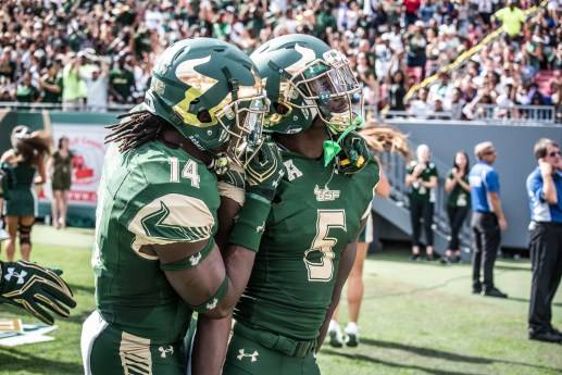 44 - USF vs. UCF 2016 - USF RB Marlon Mack celebrates TD with Deangelo Antoine in front of Raymond James Crowd #WarOnI4 by Dennis Akers | SoFloBulls.com (6016x4016)