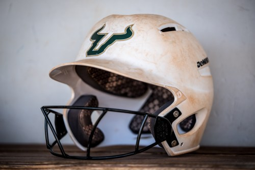 2017 USF Bulls Bulls Softball helmet in dugout by Dennis Akers | SoFloBulls.com