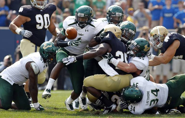 USF S Jerrell Young strips for fumble, touchdown vs. Notre Dame 2011 (3843x2450)