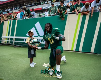 165 - Georgia Tech vs. USF 2018 - USF DB Deangelo Antoine smiles with a child after the game by Dennis Akers   SoFloBulls.com (4894x3915)