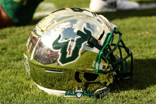 202 - Elon vs. USF 2018 - Gold USF Football Helmet on Field by Will Turner | SoFloBulls.com (4687x3126)