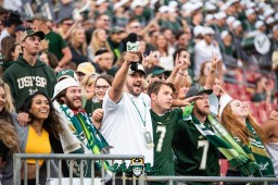 95 - Tulane vs. USF 2018 - Greg '3rd Leg Greg' Wolf in stands with USF Students at Raymond James Stadium by Dennis Akers