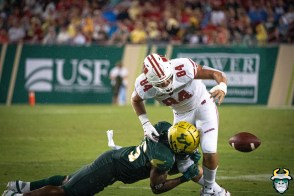 98 – Wisconsin vs USF 2019 – USF LB Patrick Macon forces fumble Jake Ferguson by David Gold – DRG06223