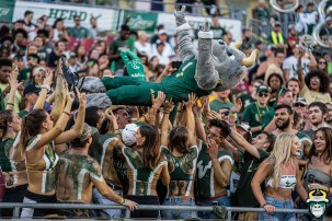 98 - BYU vs USF 2019 - Mascot Rocky D. Bull students holding up in crowd by David Gold - DRG01185