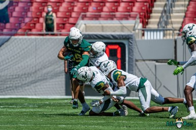 41 - USF Spring Game 2021 WR Bryce Miller stiff arm Jayden Curry Christopher Townsel DRG06445
