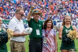 171 Florida vs USF 2021 - VP of Athletics Michael Kelly with Les and Pam Muma DRG02364