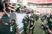 109 - USF vs. UCF 2016 - USF S Nate Godwin and OL Dominique Threatt Tyre McCants exiting with #WarOnI4 Trophy by Dennis Akers | SoFloBulls.com (6016x4016)
