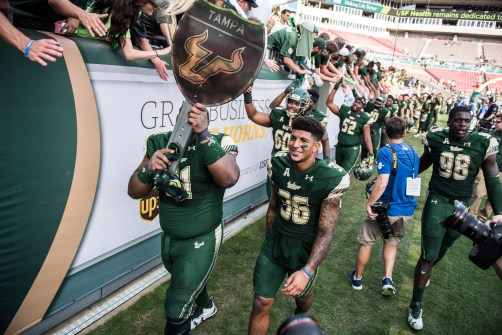 110 - USF vs. UCF 2016 - USF S Nate Godwin and OL Dominique Threatt exiting with #WarOnI4 Trophy by Dennis Akers | SoFloBulls.com (6016x4016)
