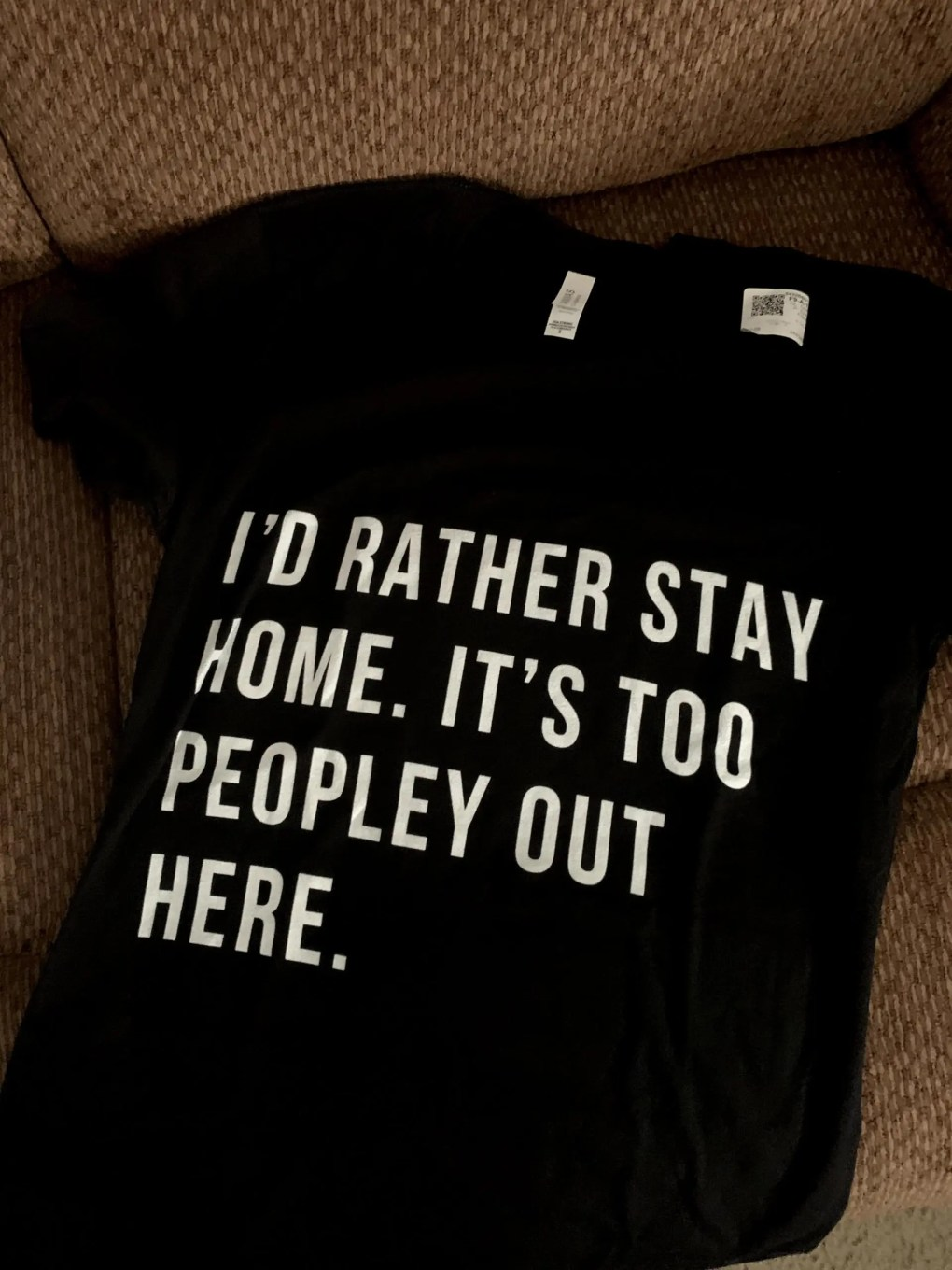 """Black short sleeved T-shirt with """"I'd Rather Stay Home. It's Too Peopley Out Here""""."""