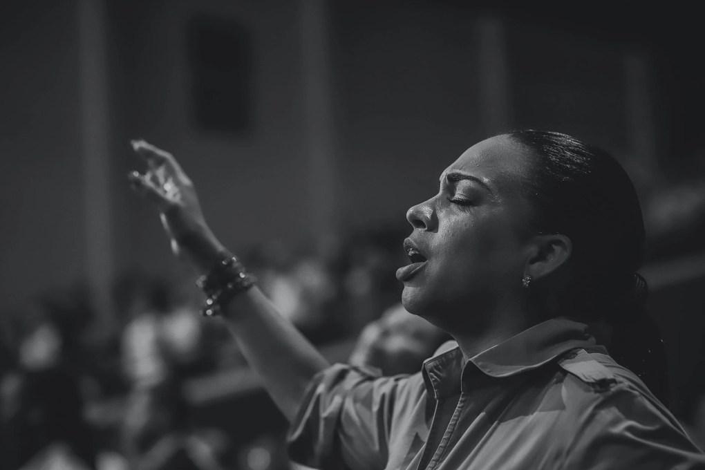monochrome photo of woman singing