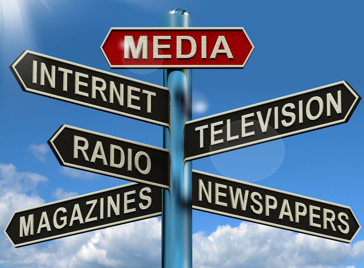 A roadsign pointing is different directions for Internet, TV, Radio, Newspapers and magazines.