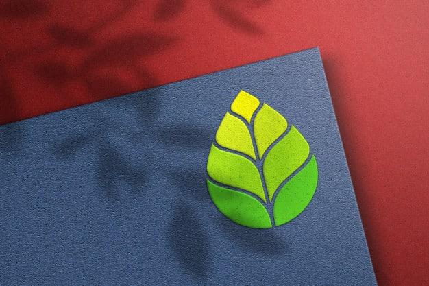 Logo mockup on blue paper Premium Psd