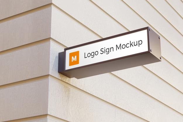Logo sign mockup rectangle signage box on facade of office building Premium Psd