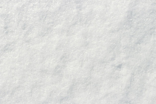White snow shining in the sun close-up texture natural background