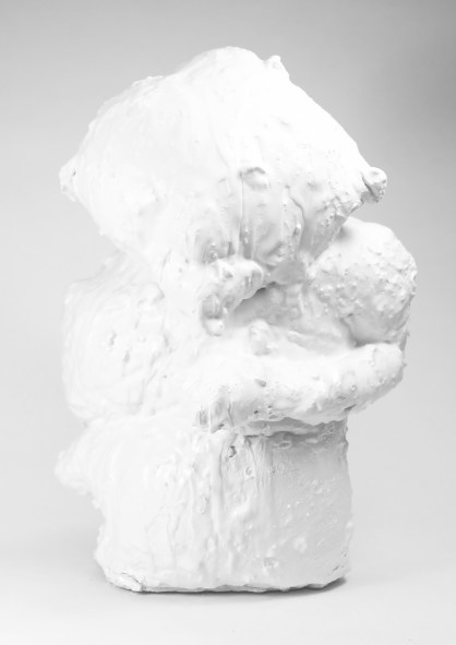 Textile troll formation coated in white cement.
