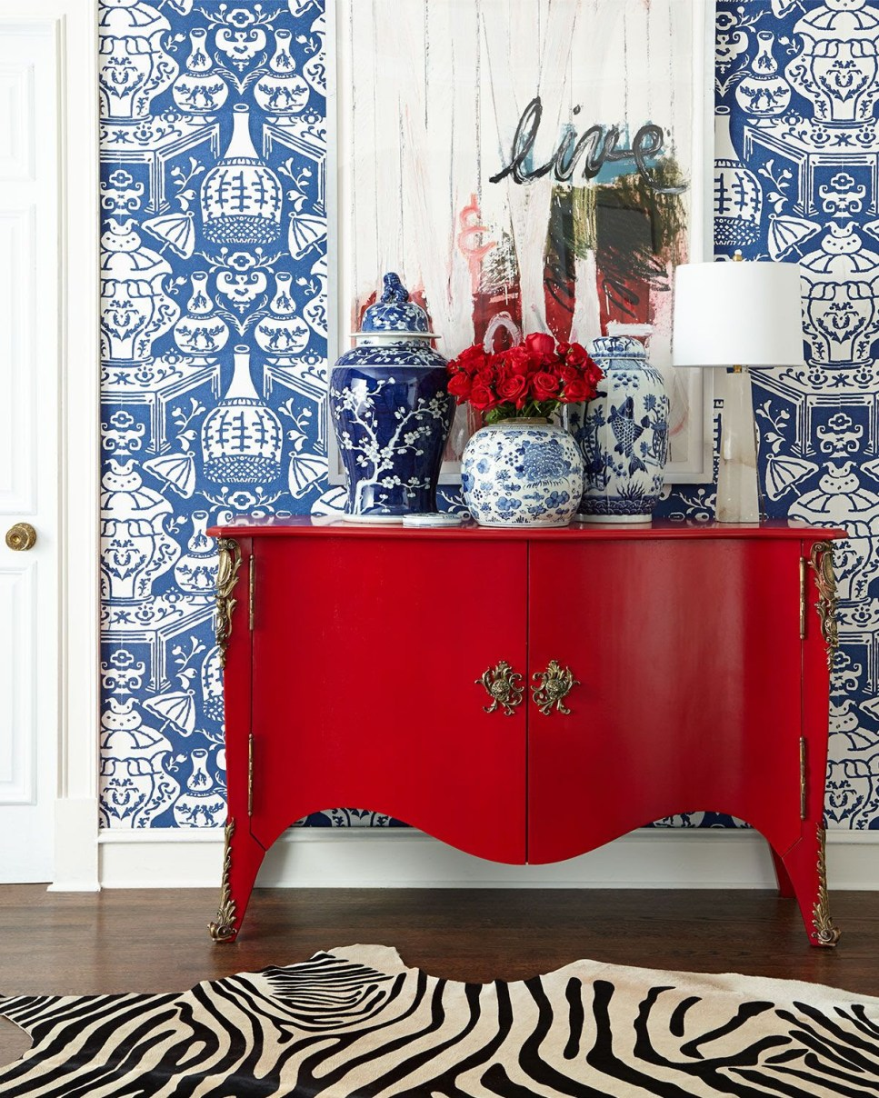 Beautiful red cabinet, with red accents and in the art, adding dramatic boldness to the space.