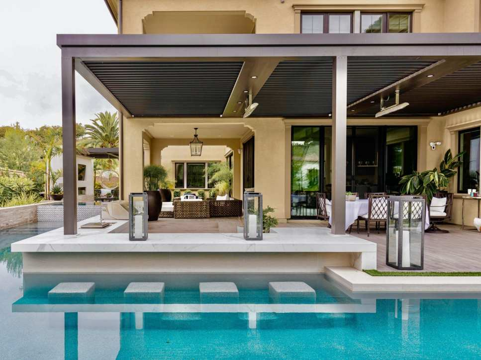 A pergola adds shade covering to the pool area.
