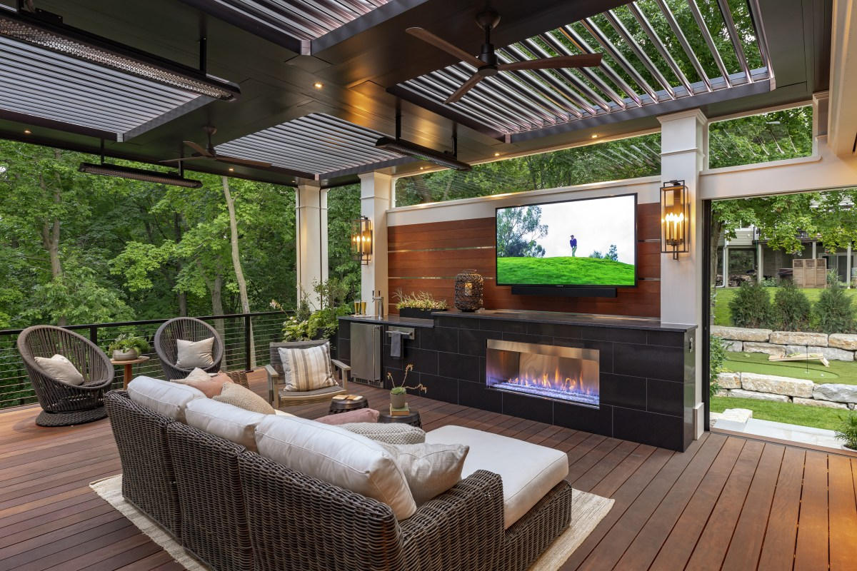 Outdoor theater under a pergola creates a staycation paradise.