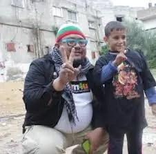 afdlin shauki bersama kanak-kanak lelaki palestin