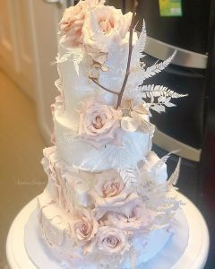 torn paper and textured fondnant fresh flower cake