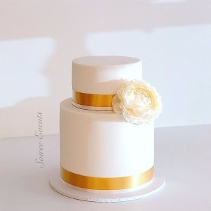 simple two tier cake with silk flower