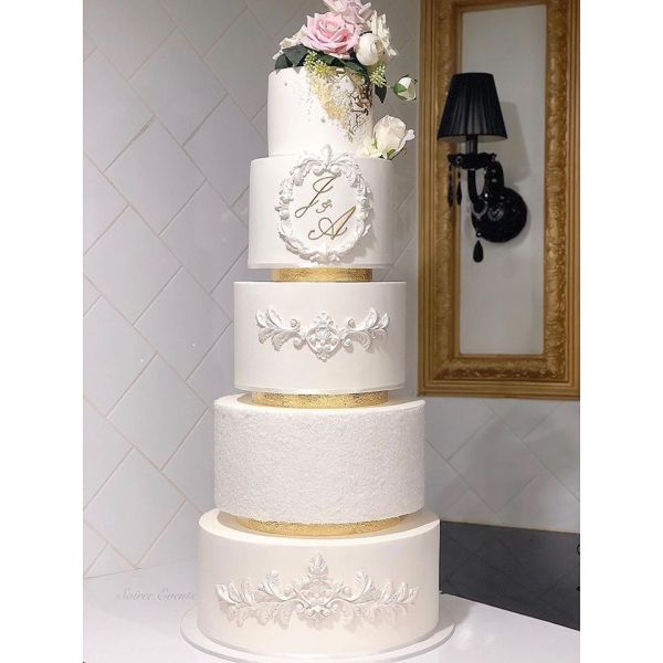 5 tier white and gold cake