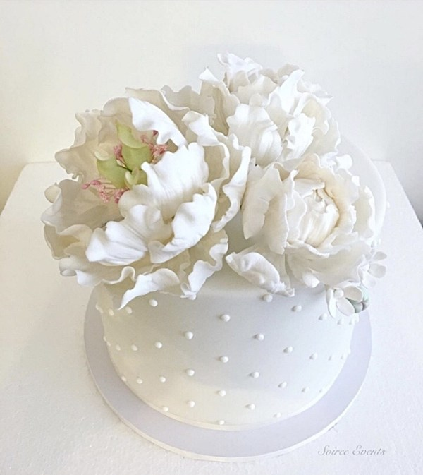 swiss dot cake with hand made sugar peonies