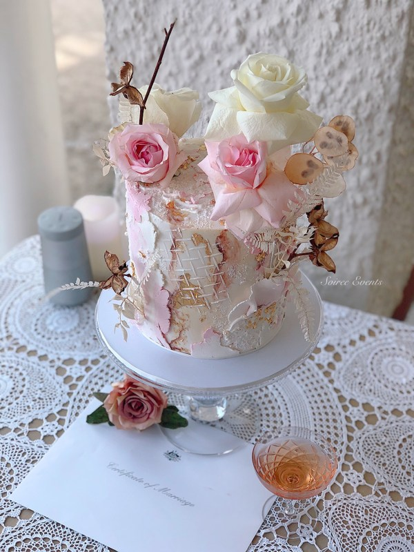 textured fondant cake with hand painted marble and preserved flowers
