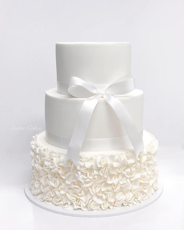 white ribbon ruffle cake
