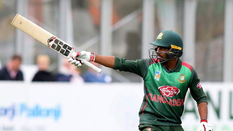 Bangladesh's Mosaddek Hossain celebrates his half century during the one-day international Tri-Nation Series final between Bangladesh and West Indies at the Malahide cricket club, in Dublin on May 17, 2019. (Photo by Paul Faith / AFP)
