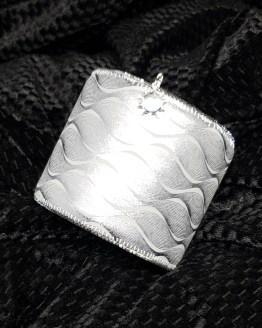Solal Bijoux Haute Fantaisie machette avec manchon réversible argent et imprimé animal noir et argent