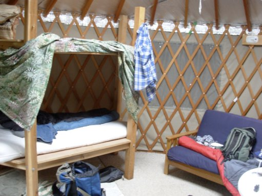 inside of yurt with bunk beds and futon