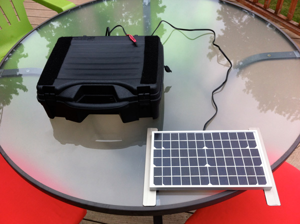 Here you can see the 10 watt solar panel is removable and attached with velcro on metal strips. The velcro holds the solar panel very securely and it all ...