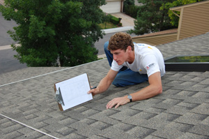 man measuring rooftop for solar installation