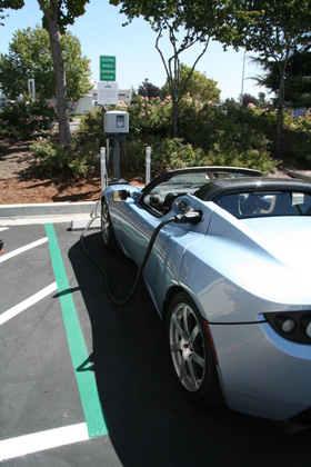 Tesla Roadster plugged into a charging station