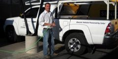 pick-up truck plugging into solar-charging station