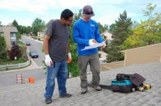 Tim (right) goes over the blueprints for our 5.5 kW solar system with Joel (left).