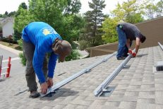 Tim (foreground) and Joel (background) install the railings for our solar system at about 1:30 p.m. on Day 1.