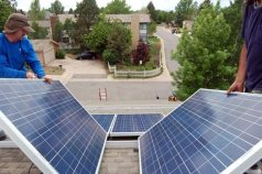 A cool shot of two solar panels glinting blue on a hot, early June day.