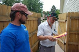 A City of Aurora Building inspector (right) signs off on our system as REC Solar Foreman Peter Karns (left) looks on.