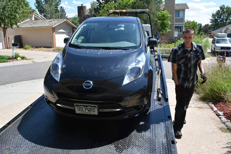 My 2014 Nissan LEAF being towed due to a flat tire. The Bridgestone Ecopia tires on my LEAF are wearing out at three times the predicted wear rate.